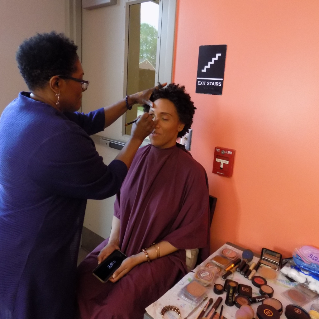 Muffy Mendoza getting her make up done for the Brown Mamas Monologues