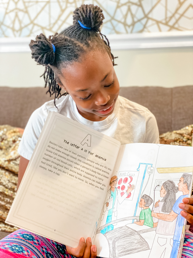 BrielleFlips on IG Holding A Sickle Cell Coloring Book for Kids